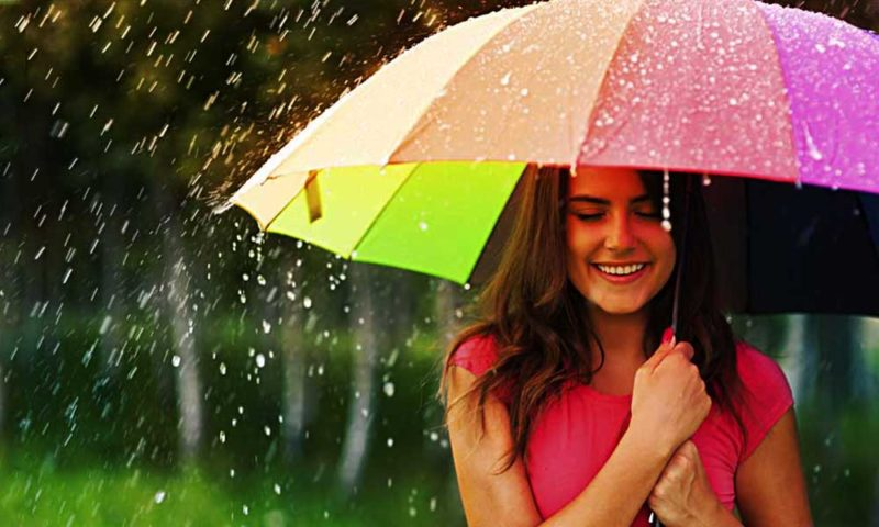Girl in Monsoon with Umbrella